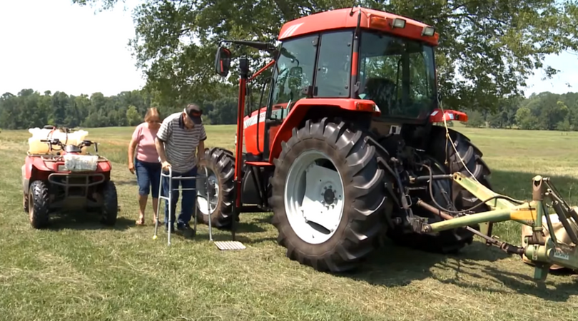 Photo of farmer using tractor lift to access his tractor